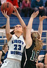 #23 for Castlewood, Kacie Jessee, goes up for shot against Eastside's #10, Madison Powers. Photo by Ned Jilton II