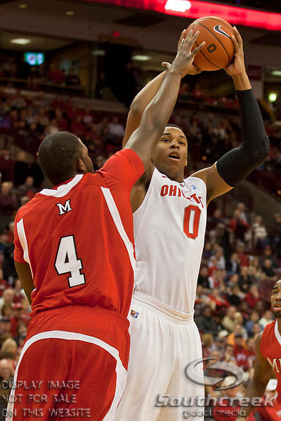 Ohio State University's Freshman Forward Jared Sullinger (#0) and Miami (OH) University's Junior Forward Julian Mavunga (#4) in the first period of play at the Value City Arena at The Jerome Schottenstein Center in Columbus, Ohio Friday afternoon November 26, 2010. The Buckeyes defeated the RedHawks 66-45.  (© James D. DeCamp / Southcreek Global Media) | All Rights Reserved | http://www.southcreekglobal.com | For all sales contact: sales@southcreekglobal.com | 1-800-934-5030