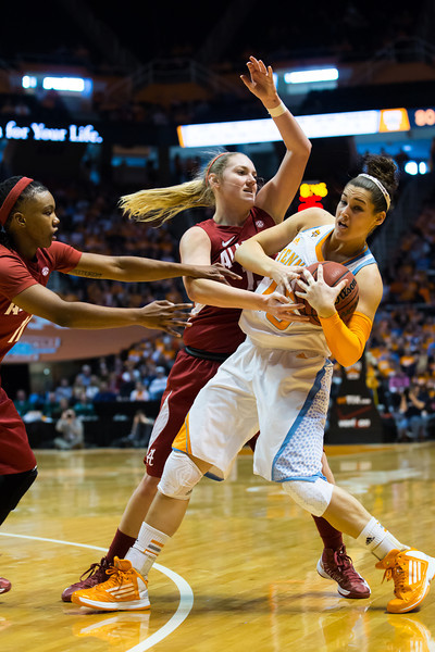 January 20, 2013: guard Taber Spani #13 of the Tennessee Lady Volunteers is guarded by Alabama Crimson Tide forward Nikki Hegstetter #13 and guard Jessica Merritt #11 during the NCAA basketball game between the University of Tennessee  Lady Vols and the University of Alabama Crimson Tide at Thompson-Boling Arena in Knoxville, TN
