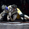 "Boulder High School's Jason Georgis tries to pin Walter Rose during a 120 lb. wrestling match against Fairview High School on Thursday, Dec. 6, at Fairview. Georgis won the match. For more photos of the match go to  <a href=""http://www.dailycamera.com"">http://www.dailycamera.com</a><br /> Jeremy Papasso/ Camera"