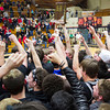 SAM HOUSEHOLDER | THE GOSHEN NEWS The Concord student section mobs Minutemen players on the court after they received the 4A Sectional trophy following their 50-45 victory over Goshen Saturday at North Side Gymnasium.