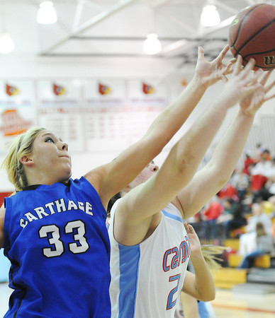 Globe/T. Rob Brown<br /> Carthage's Chloe Shepherd attempts to get hold of a rebound as Webb City's Kaitlin Beason grasps it during Monday night's game, Feb. 11, 2013, at Webb City's gymnasium.