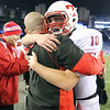 QB Johnny Aylward (10) hugs head coach Brian Aylward as Tewksbury players celebrate their increasing lead over Plymouth South late in the fourth quarter of the MIAA Division 3 Super Bowl.  (SUN/Julia Malakie)