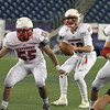 Tewksbury QB Johnny Aylward gets some cover from John Devito (55) and Alex Hamilton (79).  (SUN/Julia Malakie)