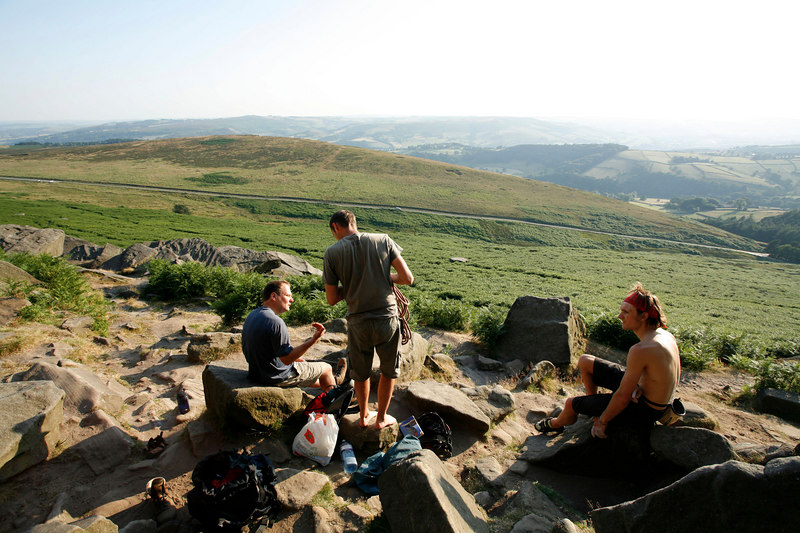 Locals chill at the base of gritstone paradise - Stanage