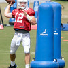 Don Knight   The Herald Bulletin<br /> Quarterback Andrew Luck passes the ball after weaving between tackling dummies during Colts practice at AU on Sunday.