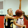 Monarch High Schools' Bridget Anthony goes for a lay-up over a Fairview High School defender on Tuesday, Jan. 10, during a game at Fairview High School. Monarch won the game 55-34. For more photos of the game go to www.dailycamera.com Jeremy Papasso/ Camera