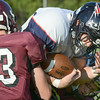 #16 for Sullivan East lowers his head and bangs his way between two Johnson County defenders. Photo by Ned Jilton II