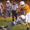 #44 for Sullivan Central fights for extra yardage against #81 for South Green to set-up the touch down on next play. Photo by Ned Jilton II