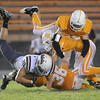 #20 for South Green is brought down by a host of Cougar defenders. Photo by Ned Jilton II