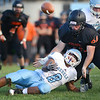 #8 for Sullivan South loses the ball while being hit by #61 of Elizabethton during Three Rivers Jamboree. Photo by Ned Jilton II