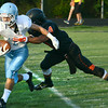 #1 for Sullivan South is driven out of bounds by Elizabethton defender. Photo by Ned Jilton II