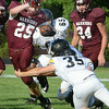 #25 for Happy Valley eludes two Sullivan North tacklers. Photo by Ned Jilton II
