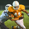 #44 for Sullivan Central fights for extra yardage against #5 for South Green to set-up the touch down on next play. Photo by Ned Jilton II