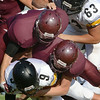 #9 for Sullivan North holds onto the ball as he finds himself on the bottom of a stack of players. Photo by Ned Jilton II