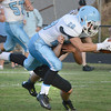 #28 for Sullivan South dives over Elizabethton defender for the Touchdown. Photo by Ned Jilton II