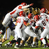 Carl Junction's defense piles up on a Monett ball carrier Friday night, Oct. 25, 2013, at Monett's Burl Fowler Stadium.<br /> Globe | T. Rob Brown