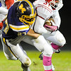 Carl Junction's Keynan Scheurich gets brought down by Monett defender Cameron Witt Friday night, Oct. 25, 2013, at Monett's Burl Fowler Stadium.<br /> Globe | T. Rob Brown