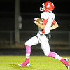 Carl Junction's Dustin Satterlee runs through the end zone while scoring a touchdown against Monett Friday night, Oct. 25, 2013, at Monett's Burl Fowler Stadium.<br /> Globe | T. Rob Brown