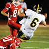 Carl Junction's Christian Pittman brings down Cassville quarterback Gabe Kirk during Friday night's game, Sept. 27, 2013, at Carl Junction's field. Globe | T. Rob Brown
