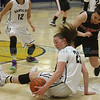 Santa Fe's Sabrina Lozada-Cabbage, number 25, recovers her own loose ball during the first quarter of the Santa Fe High School vs Grants High School at Santa Fe High School on Friday, March 7, 2014. Luis Sanchez Saturno/The New Mexican