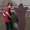 Avon Lake's Matt Duskey get advice from a mysterious shadowy figure at the SWC tournament at Avon Lake High School.  Photo by Ray Riedel