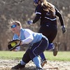 Dracut vs Methuen softball. Methuen's Kelly Blackwell (10) is safe at first on a ground ball as Dracut first baseman Emily Vallante (30) fields the throw in the bottom of the third. (SUN/Julia Malakie)