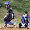 Dracut vs Methuen softball. Methuen's Meghan Murphy (16) is safe at third as the throw from the outfield gets past Dracut third baseman Jen Gomes (29) in the bottom of the fifth inning. (SUN/Julia Malakie)