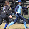 Dracut vs Methuen softball. Dracut's Kaylee Kacavas is caught in a rundown between third and home, but got back to third safely despite being chased by Methuen pitcher Kayleigh Forgetta (5) in the top of the third inning. (SUN/Julia Malakie)