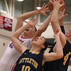Tewksbury's Justin Derrah (42) and Littleton's Mike Wilson (10) and Alex McLaughlin (4) reach for a rebound. (SUN/Julia Malakie)