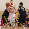 Tewksbury's Joe Csokmay (50) tries to get past an unidentified Littleton player and Mike Wilson (10). (SUN/Julia Malakie)