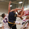 Littleton's Travis Bassett (5) and Tewksbury's Justin Derrah (42) and Adam Cajjaoul (23). (SUN/Julia Malakie)