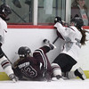 Westford Academy vs Chelmsford girls hockey. Westford Academy's Kelsey Doran (16) and Olivia Peterson (20), and Chelmsford's Julia Squeri (13). (SUN/Julia Malakie)