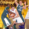 Elyria Catholic's DJ Graham and Avon's Dan Durrin fight for the ball.  LINDA MURPHY/CHRONICLE