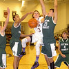 Avon's Dan Durrin drives between Elyria Catholic's Ceeven Shelton, left, and Jeremy Holley. LINDA MURPHY/CHRONICLE