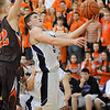 Keystone's Austin Conrad gets past the block of Buckeye's Chris Vogt in the fourth quarter friday night at Keystone.