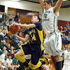 North Ridgeville's Jordan Montgomery drives past Elyria Catholic's Jeremy Holley. STEVE MANHEIM/CHRONICLE