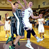 An Elyria Catholic player drives past Vermilion's Ross Lewis. LINDA MURPHY/CHRONICLE