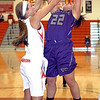 Keystone's Darcy Irish fights to shoot past Fairview's Bri Kovacevich. LINDA MURPHY/CHRONICLE