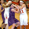 Keystone's McKenah Peters fights Fairview's Rachel Malloy and Megan Coyne for the ball. LINDA MURPHY/CHRONICLE