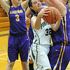 Elyria Catholic's Becky Horvath is blocked by Lakewood's Megan Barrett. STEVE MANHEIM/CHRONICLE