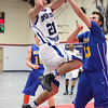 Open Door's sophomore J.P. Miraldi goes up for two against Independence player Mike Martin. photo by Ray Riedel