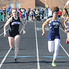 Emily Peters of Keystone and Jocelynn Rogers of Lorain race in the girls 100 meter dash preliminary event. STEVE MANHEIM/CHRONICLE