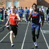 Joe Schtscherbak of Elyria and Amani Crowley of Oberlin compete in the boys 100 meter dash preliminaries. STEVE MANHEIM/CHRONICLE