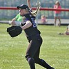 Keystone's Mckenah Peters throws the ball into the infield in Thursday's regional semifinal game against Perkins. AMANDA K. RUNDLE/CHRONICLE
