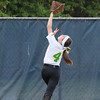 Amherst right fielder Madyson Harris tries to catch a fly ball. CHRISTY LEGEZA/CHRONICLE