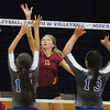 Avon Lake's Emily Schillinger hits over Midview's Alyssa Seljan, left, and Paige Surman. STEVE MANHEIM/CHRONICLE