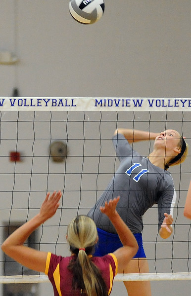 Midview's Cassie Height prepares to hit the ball against Avon Lake during a non-conference match Wednesday night. STEVE MANHEIM/CHRONICLE