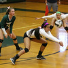 Elyria Catholic's Josie Carandang goes low for a return as Lydia Wetzel and Sarah Schuckman look on during Wednesday's match against Brookside. CHRISTY LEGEZA/CHRONICLE
