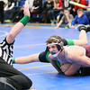 Wellington's Down's pins Mogadore's Newman to win 106 lb class in Div III sectional tournament at Independence High School. photo by Ray Riedel